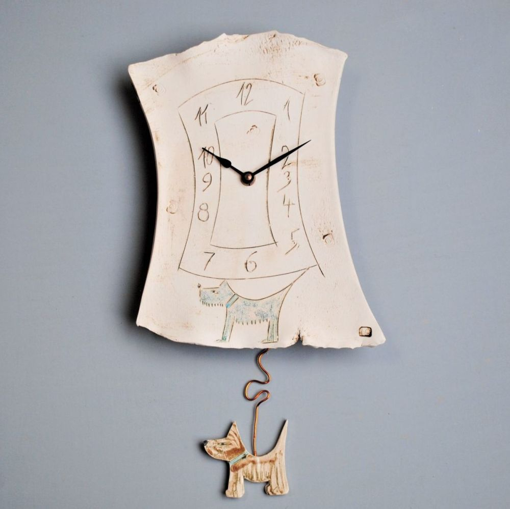 Handmade ceramic pendulum wall clock with dog motif.