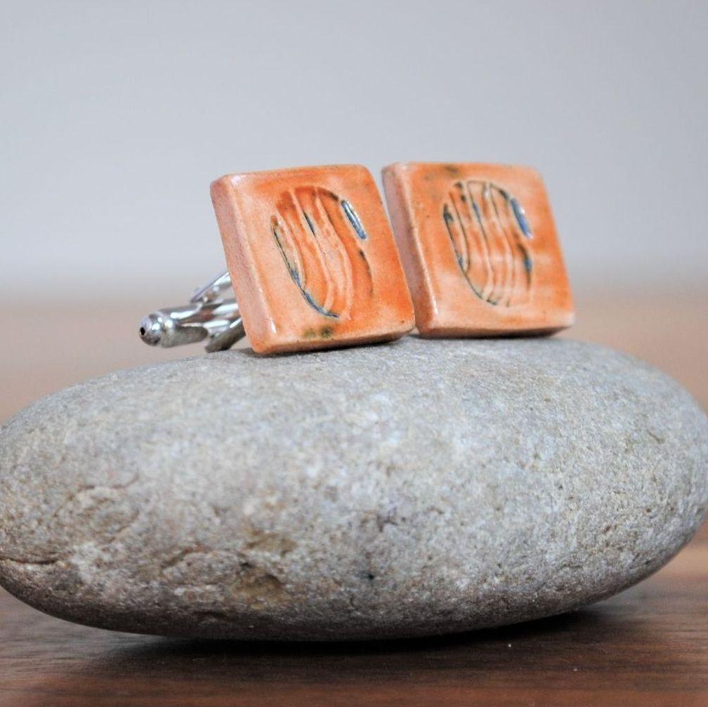 cufflinks - brown/orange