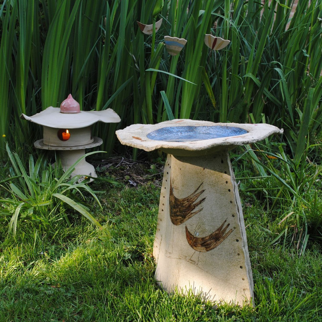 Ceramics for outdoor, including a bird bath, large lantern and garden/pot stakes.