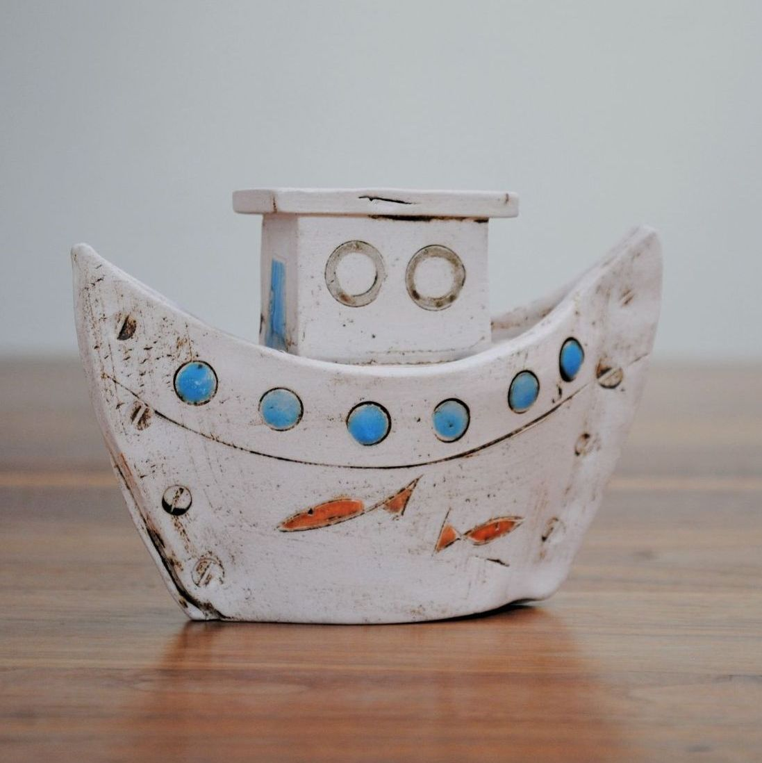 Small ceramic boat from white clay.