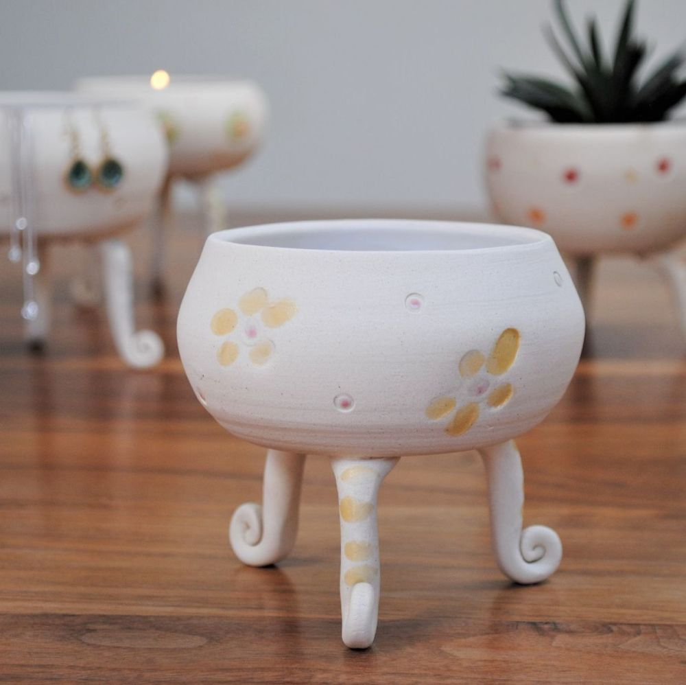 Multifunctional ceramic tripod vessel made from white clay and decorated wi