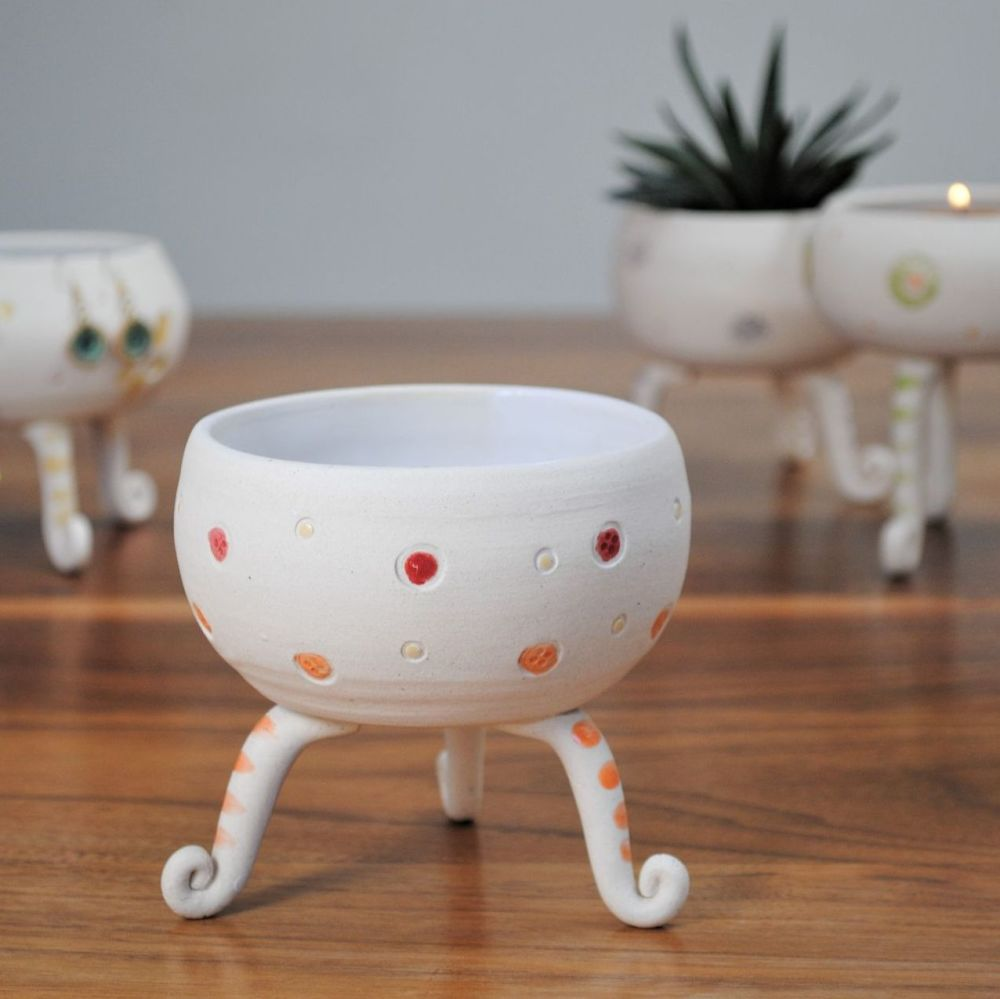 Ceramic tripod vessel  handmade from white clay and decorated with red and
