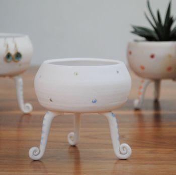 ceramic tripod vessel - white with green, blue & gray dods