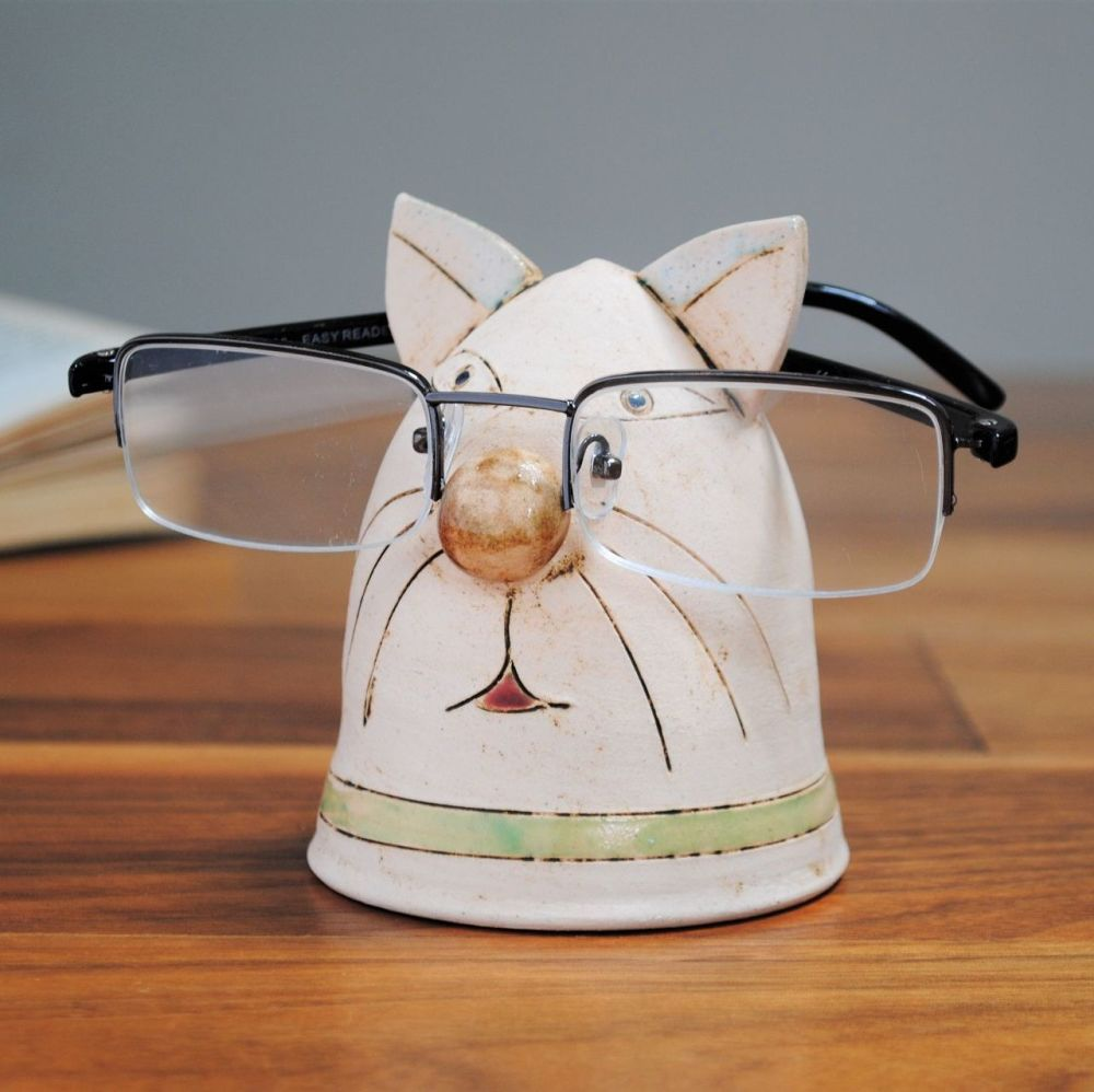 Handmade ceramic glasses holder cat design, made from a white clay and deco