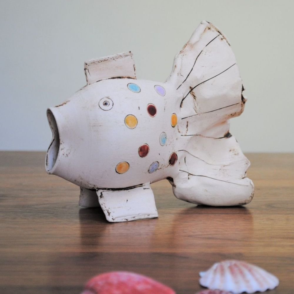 Ceramic large fish decorated with multicoloured dots.