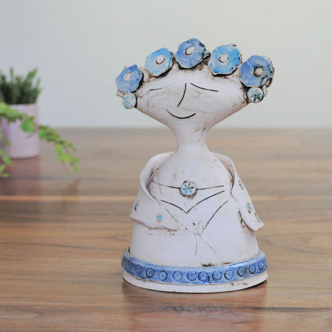 Small lady sculpture thrown on the pottery wheel, amde of white clay and de
