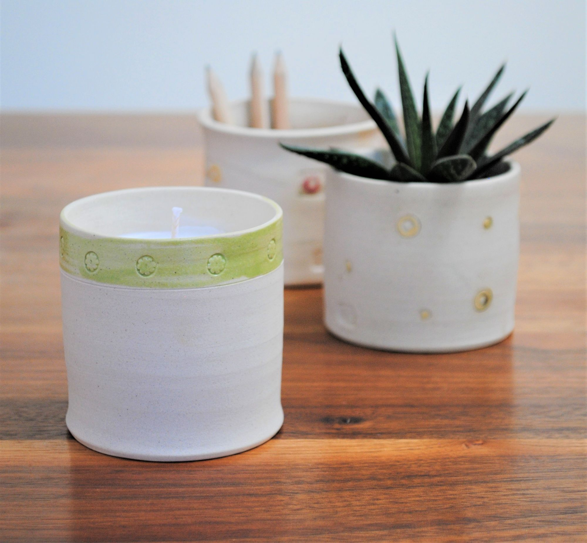 scented candles in a reusable ceramic pot