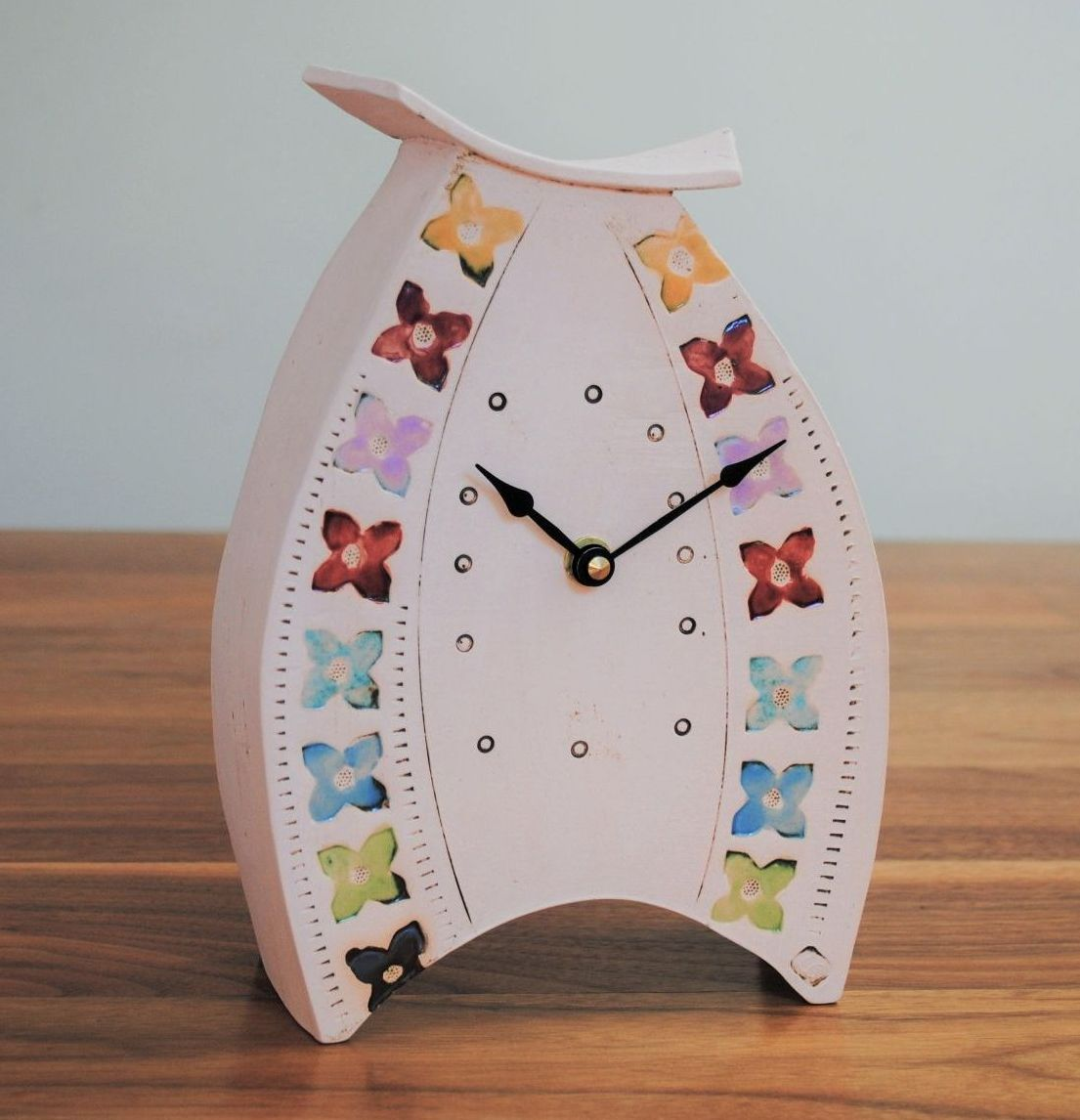 Large ceramic mantel clock in white clay with multicolour prints.