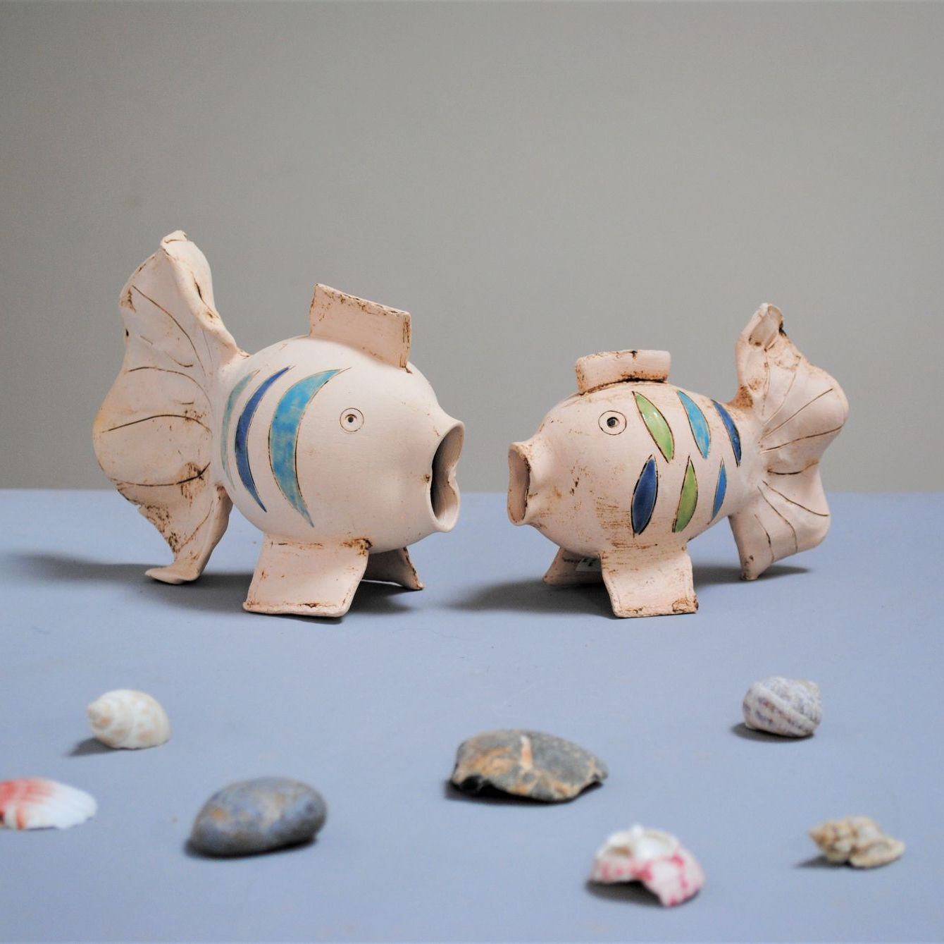 Ceramic decor fish in white clay with colourful dots.
