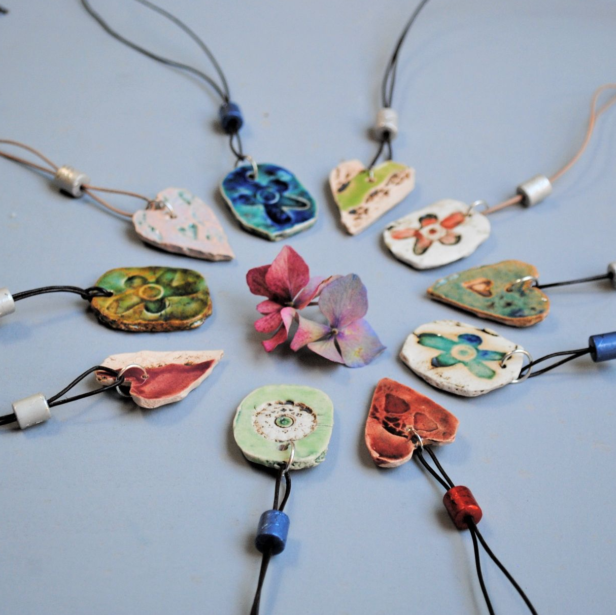 Handmade ceramic jewellery including pendants, earrings, cufflinks and bracelets.