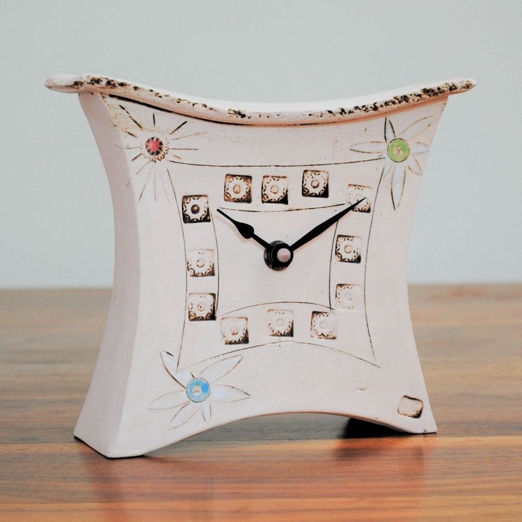 Handmade ceramic mantel clock from a white clay and decorated with daisy fl