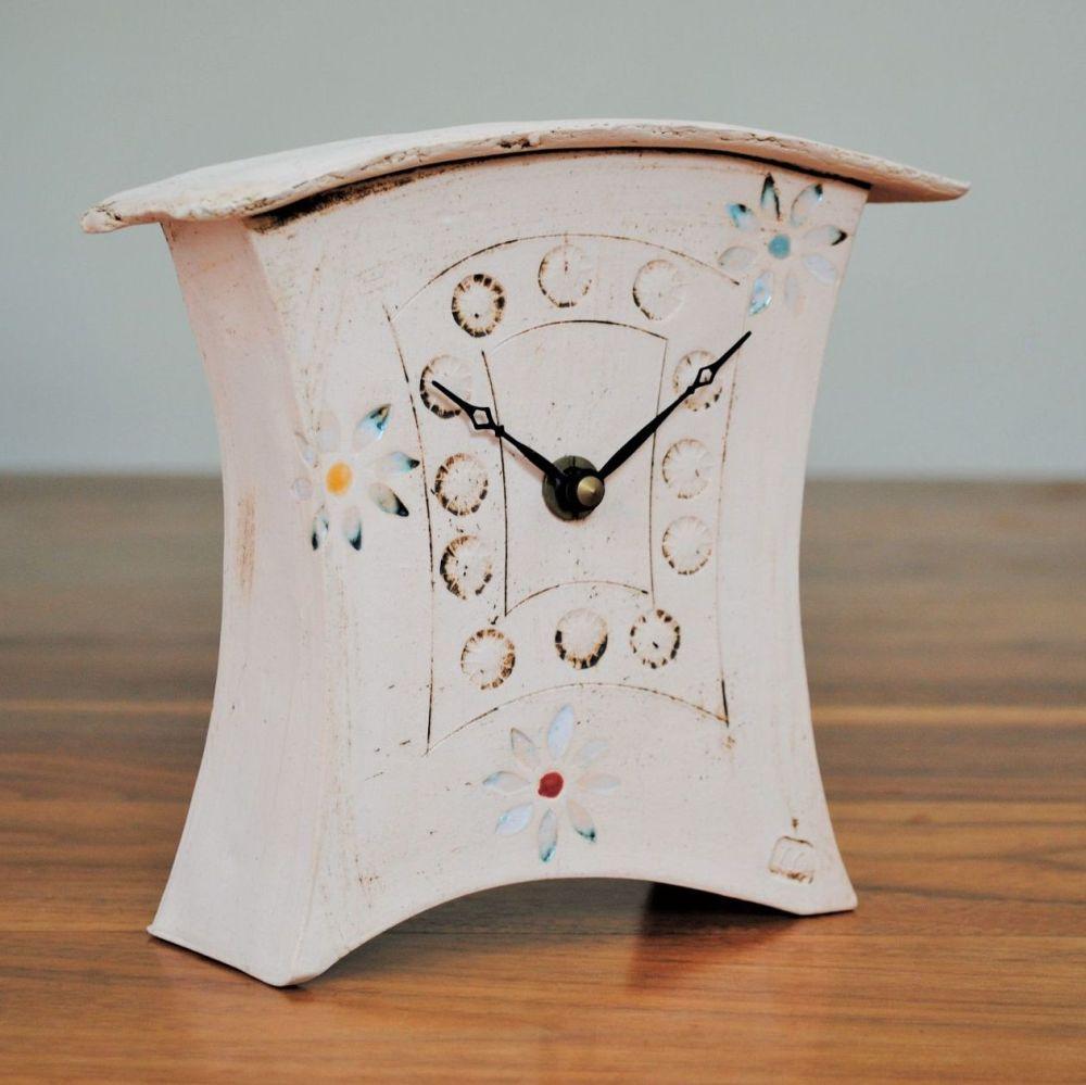 Handmade ceramic mantel clock with daisy flower print.