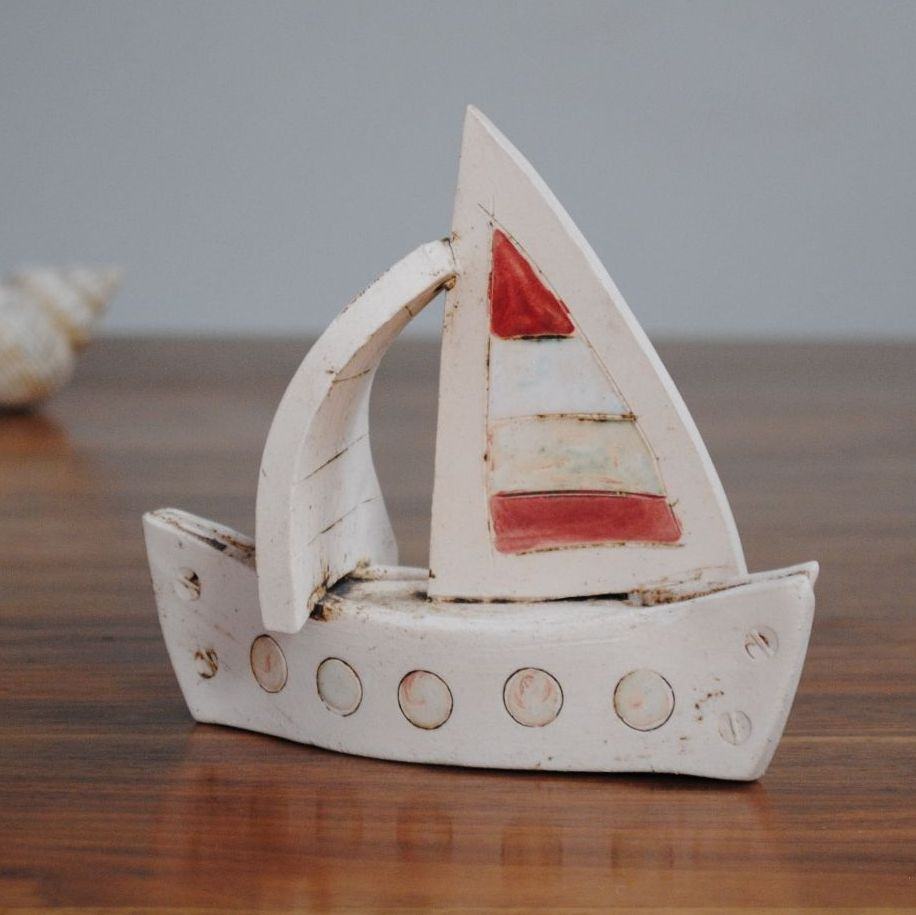 A small decorative Sailing boat, handmade from a white clay. Small