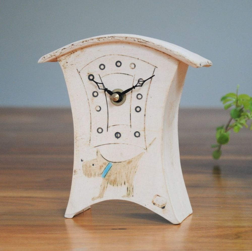 Handmade ceramic mantel clock with a dog design on the front.