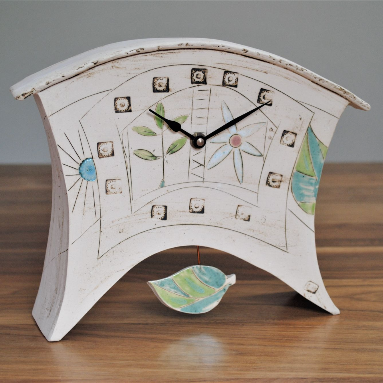 Pendulum ceramic mantel clock bright colours.