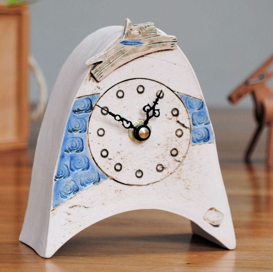 Handmade ceramic mantel clock with dog design.