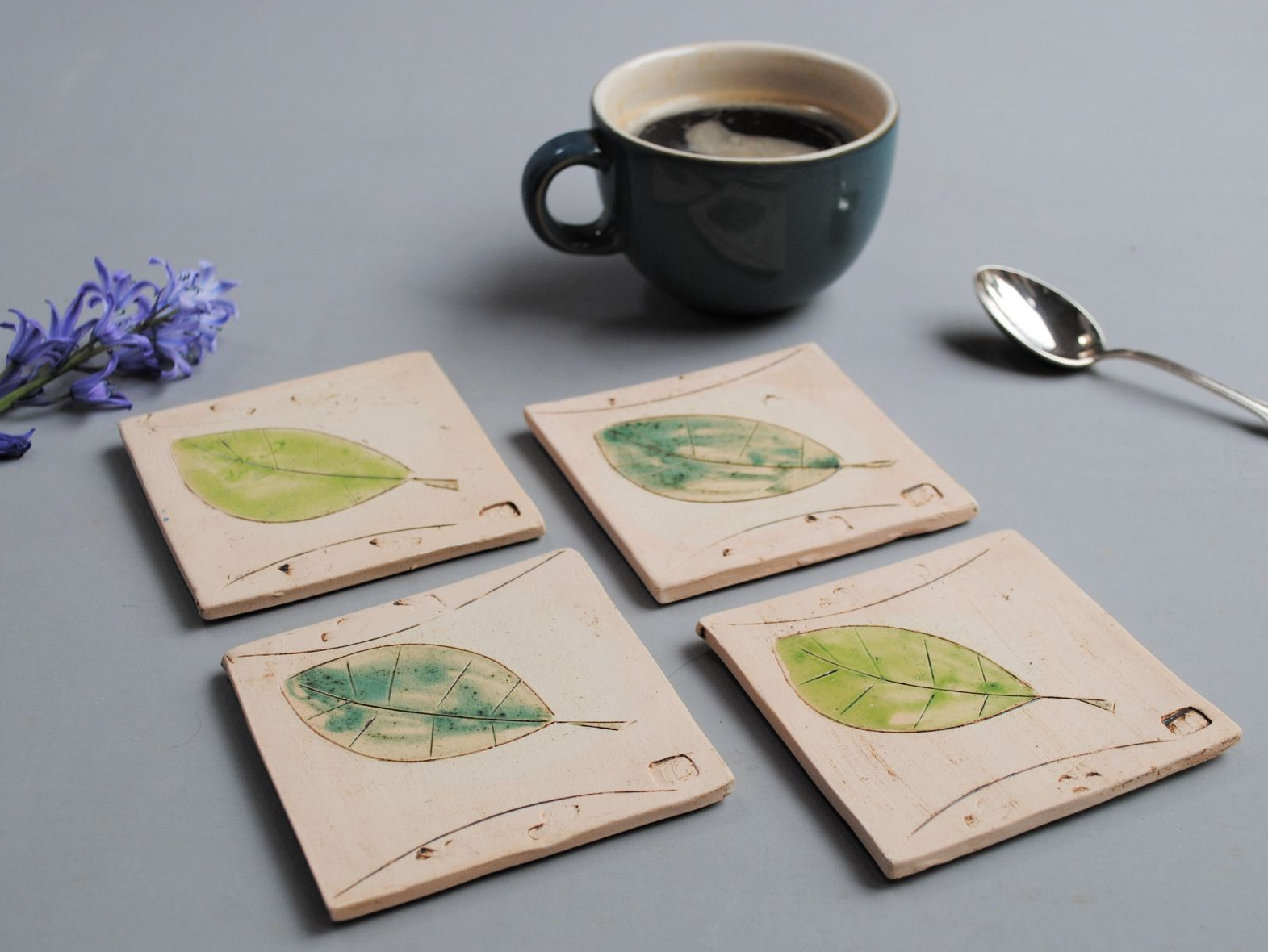 set of coasters with leaves design