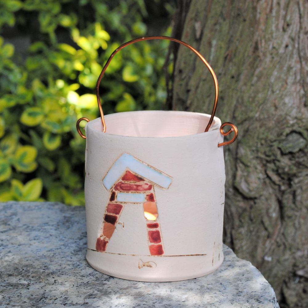 Ceramic tealight holder with flower print.