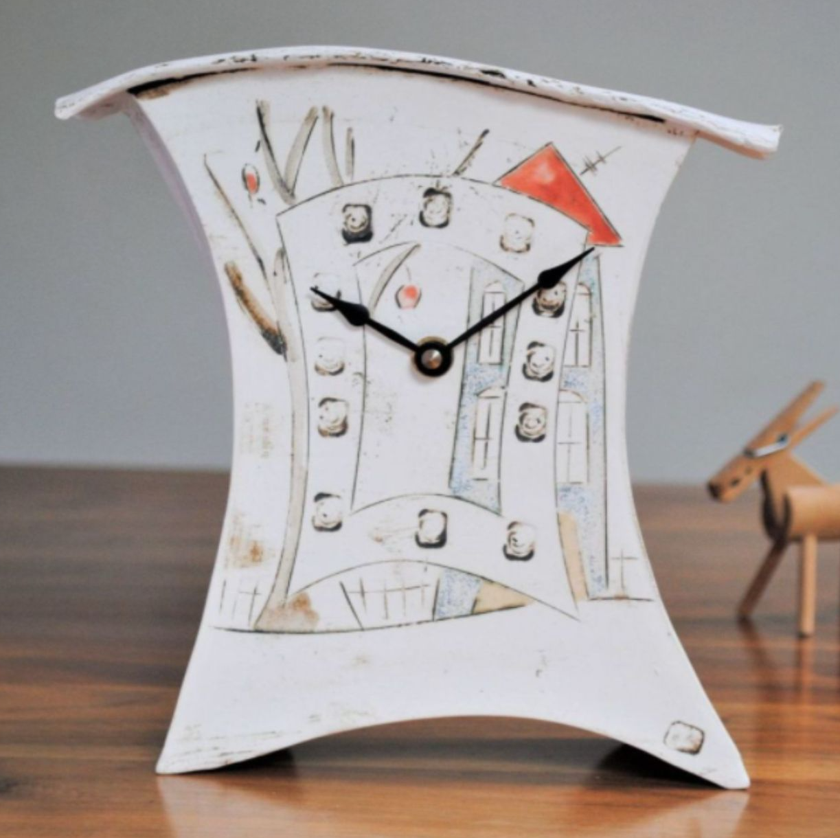 Mantel clock with house design.