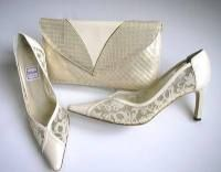 Renata cream leather shoes lace -seed pearls   matching bag size  5.5