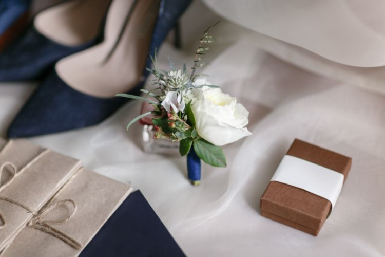 Flower arrangement next to navy heels