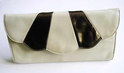 Renata vintage designer envelope clutch.beige/gold .used