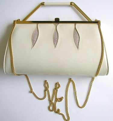 Designer bag by Gina 3 way ivory kid leather .used