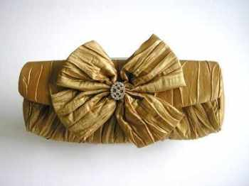 Dents evening clutch bag metallic gold large bow with jewel
