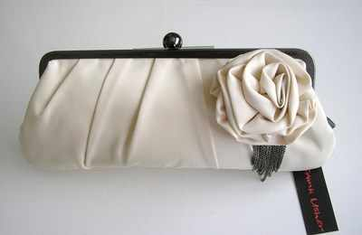 Designer bag Frank Usher beige satin clutch .rose feature.