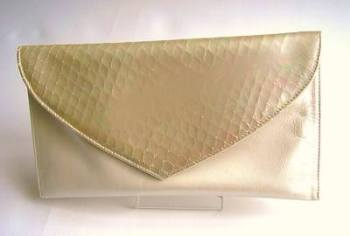 Renata cream envelope clutch with snakeskin pattern flap