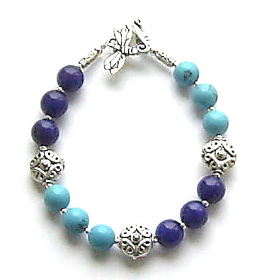A LAPIS LAZULI AND TURQUOISE CELTIC STERLING SILVER BRACELET
