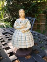 Girl with doll candle holder