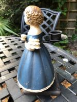 Girl with cup of tea candle holder