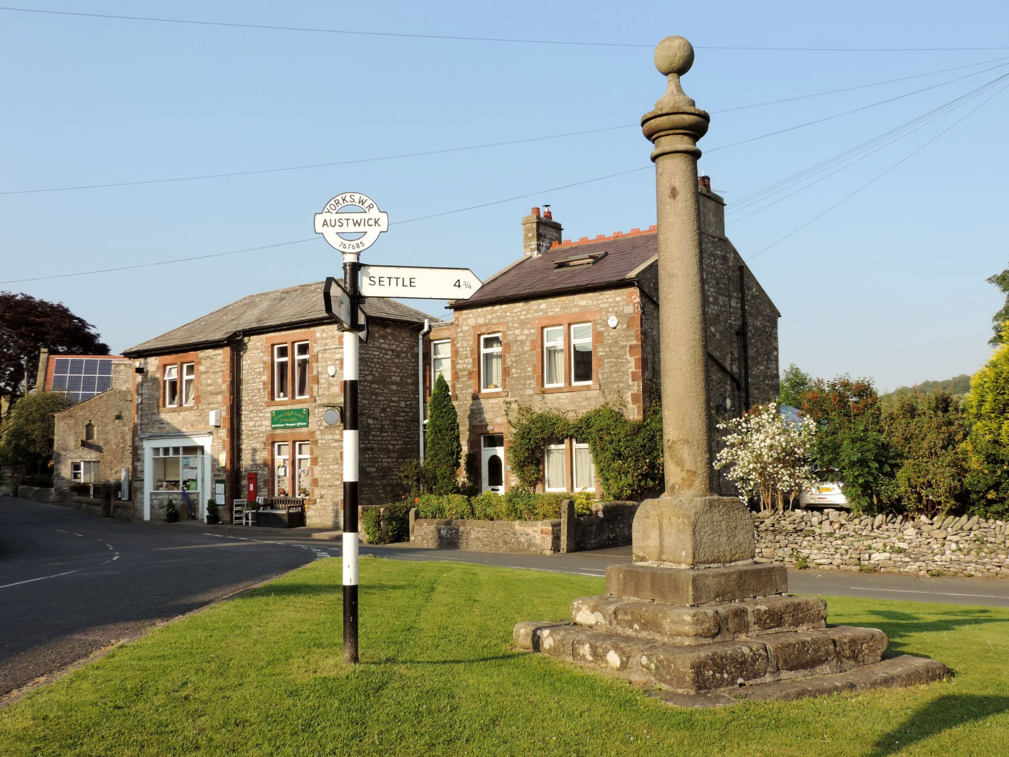 Market Cross on the village green in Austwick