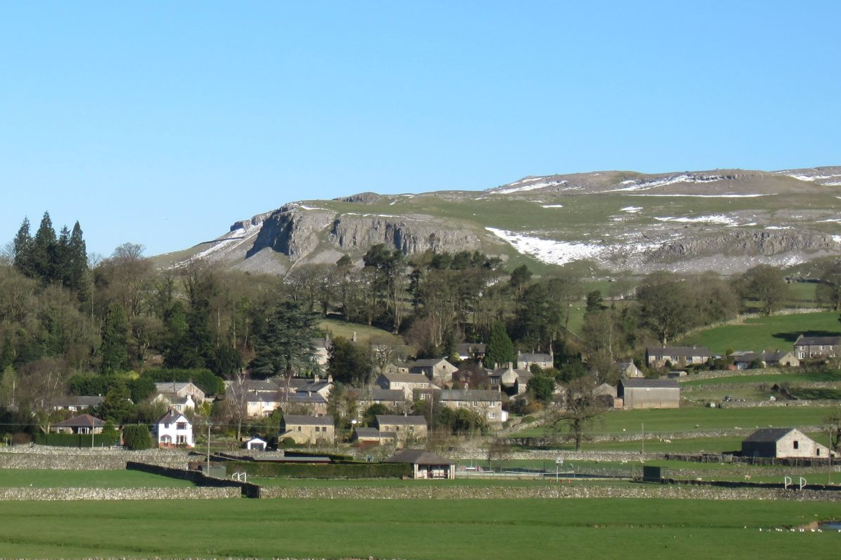 Hills and rock scar above Austwick village