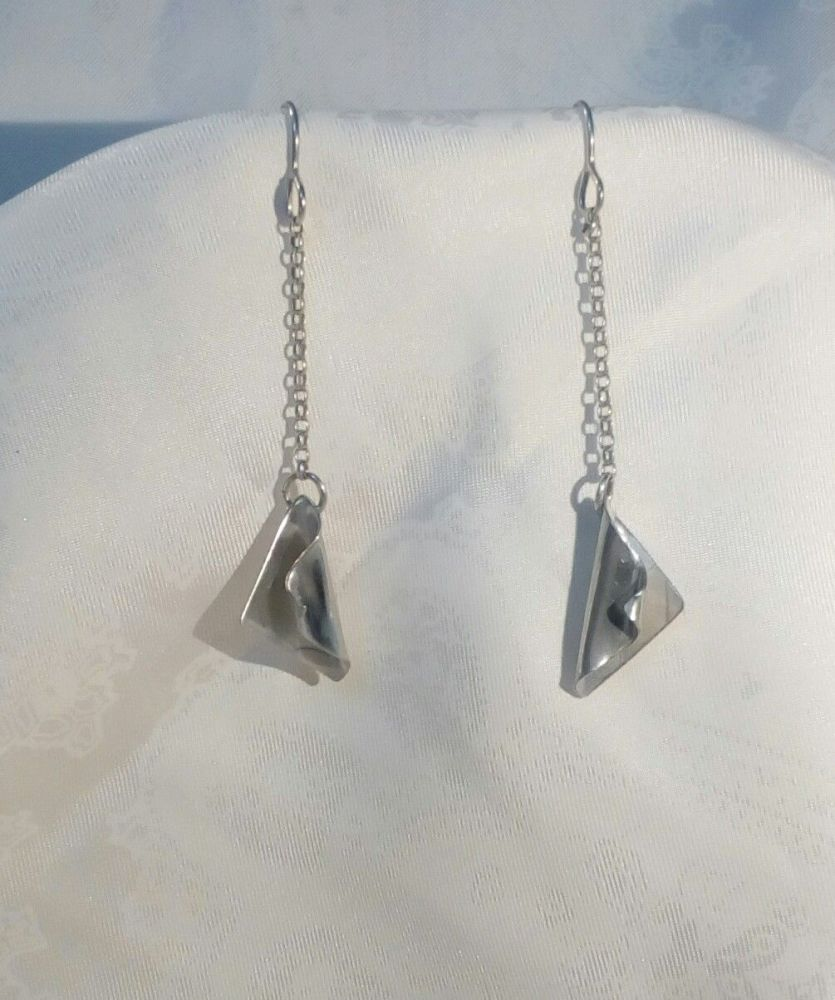 Silver earring on a delicate sterling silver chain
