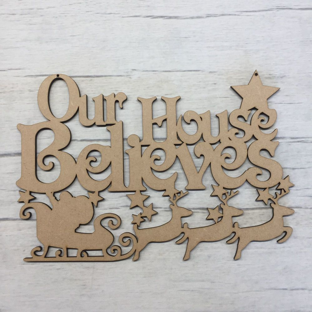 Christmas 'Our House Believes' plaque.