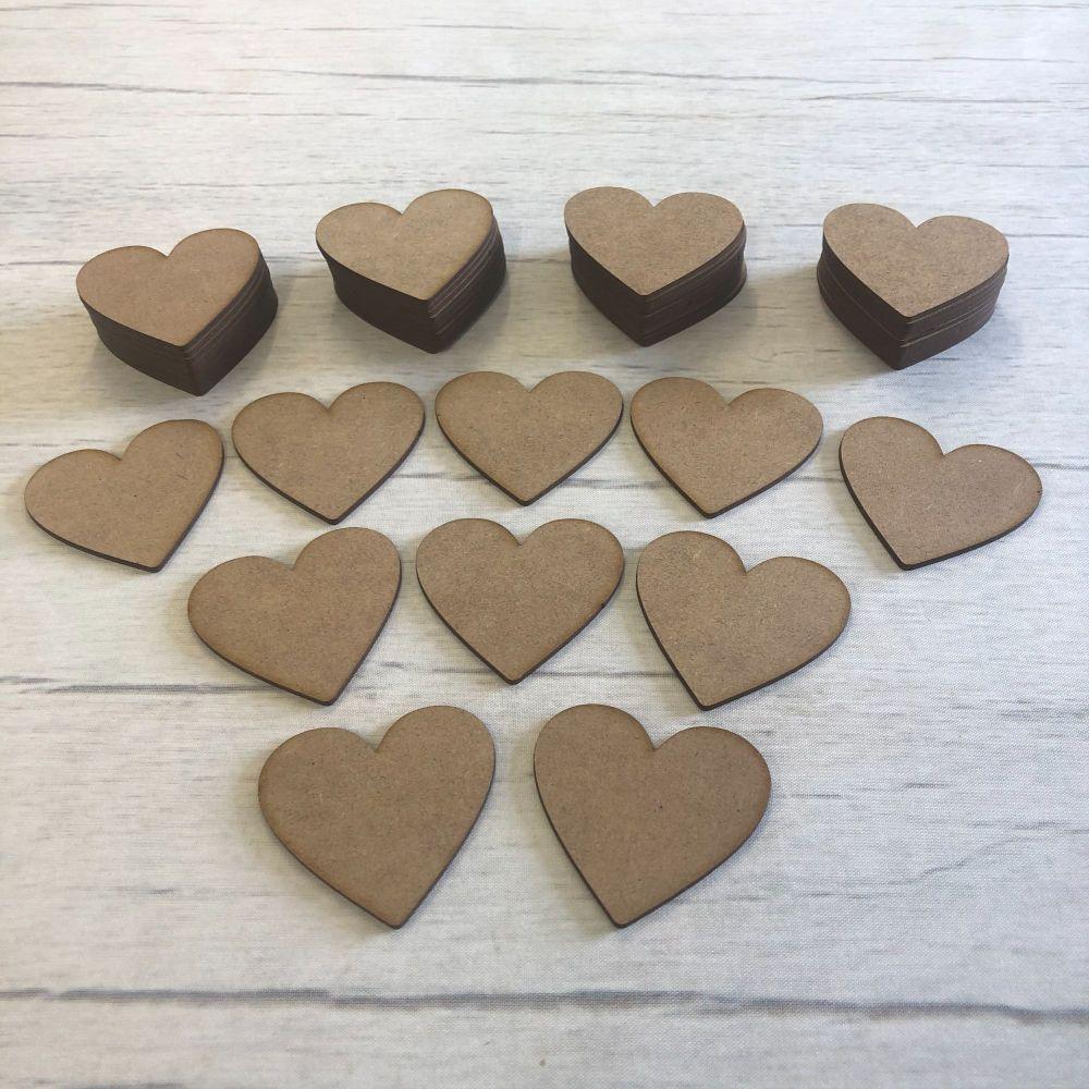 Embellishments set of 50 hearts 5cm
