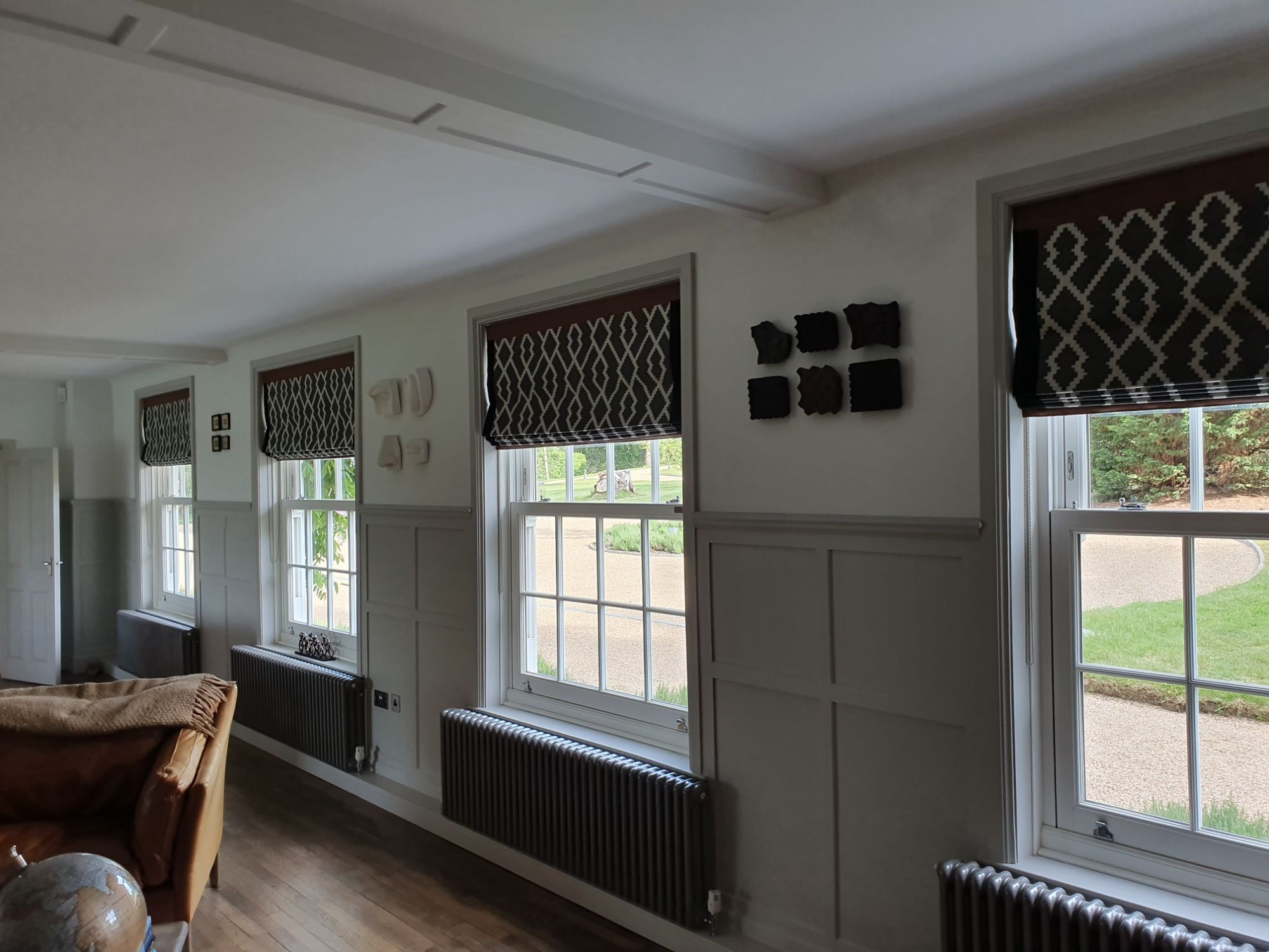 Roman blind sevenoaks leather border with geometrical fabric
