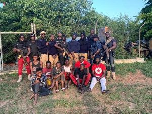 Ghanian security forces posing with captured alleged kidnappers