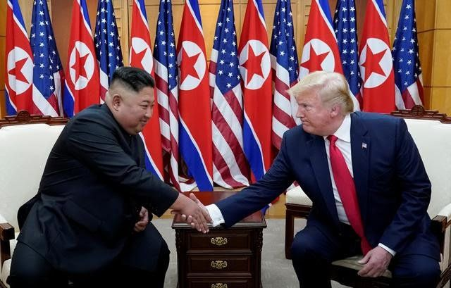 FILE PHOTO: U.S. President Donald Trump shakes hands with North Korean leader Kim Jong Un as they meet at the demilitarized zone separating the two Koreas, in Panmunjom, South Korea, June 30, 2019.  REUTERS/KEVIN LAMARQUE/FILE PHOTO