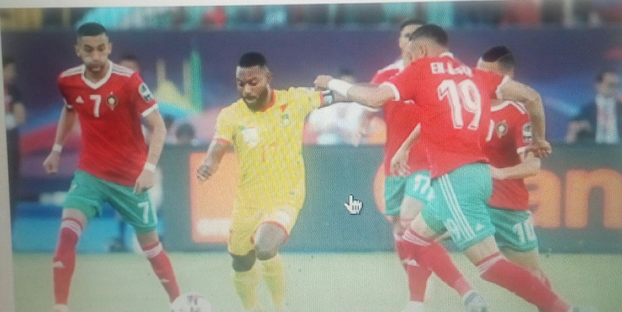 Stephane Sessegnon of Benin surrounded by Morocco players.