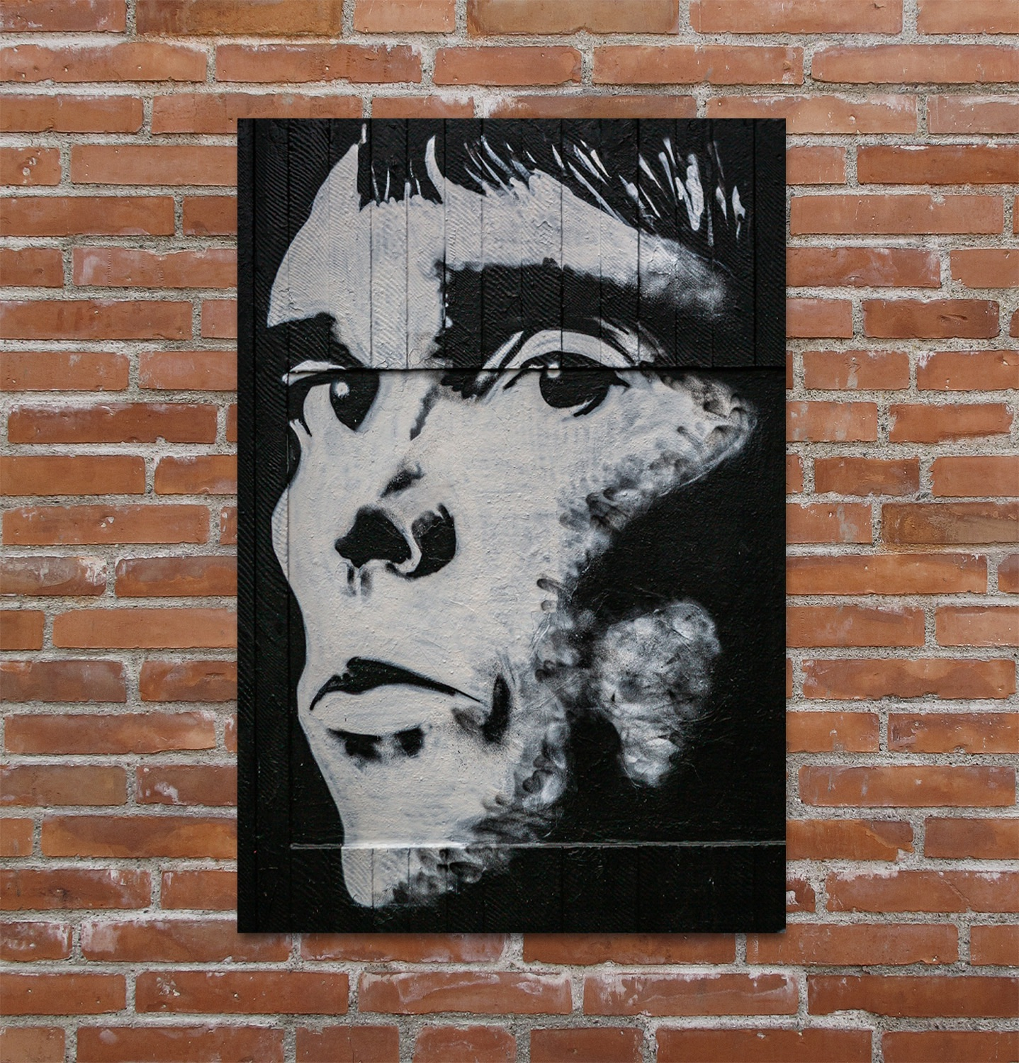 Monochrome graffiti art of Manchester music icon Ian Brown of the Stone Roses.