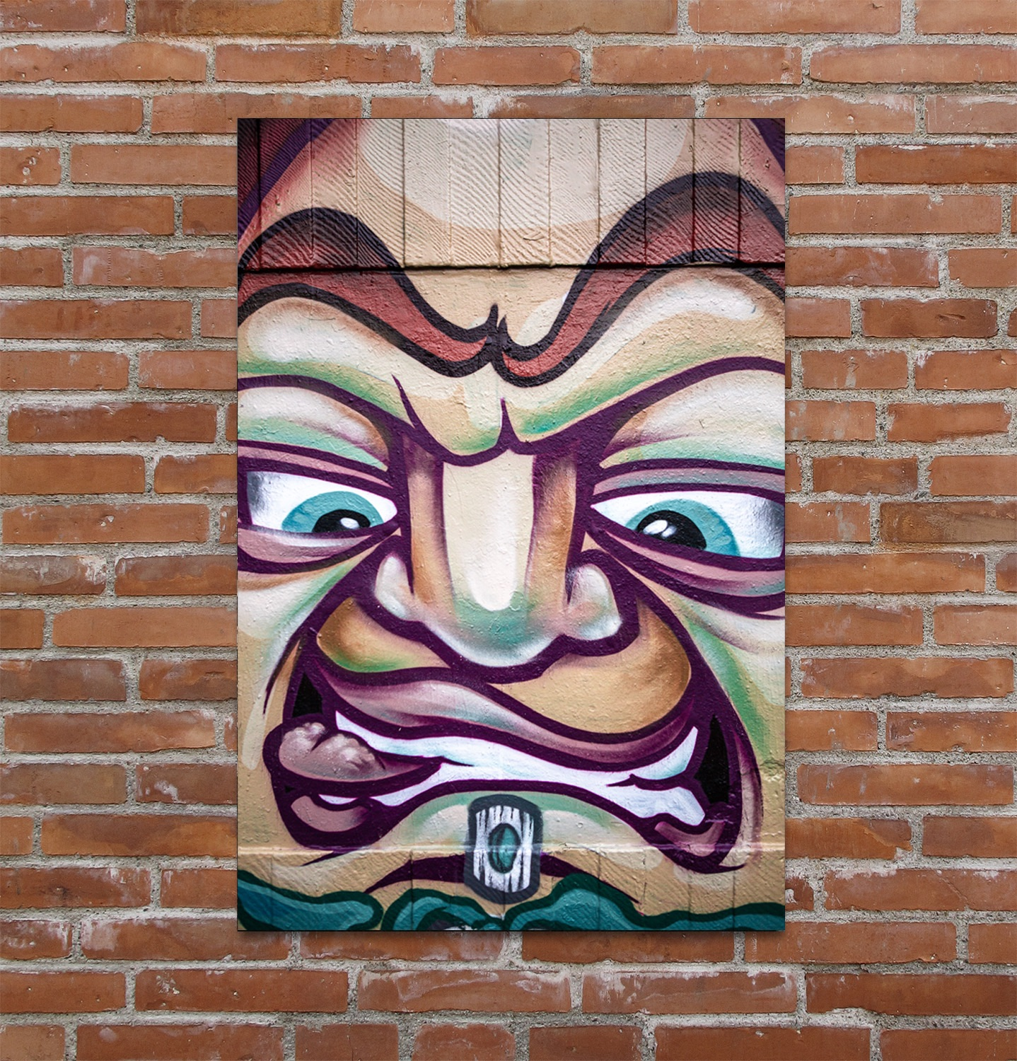Snarling caricature graffiti art in Manchester.