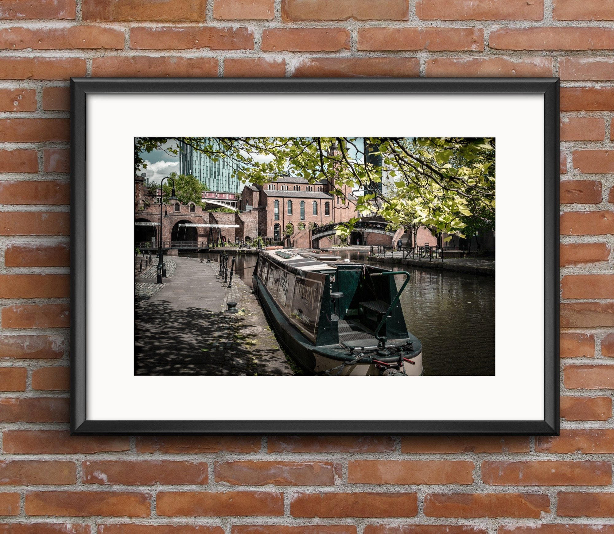 Decorated barge moored at Castlefield Canal, spring scene.