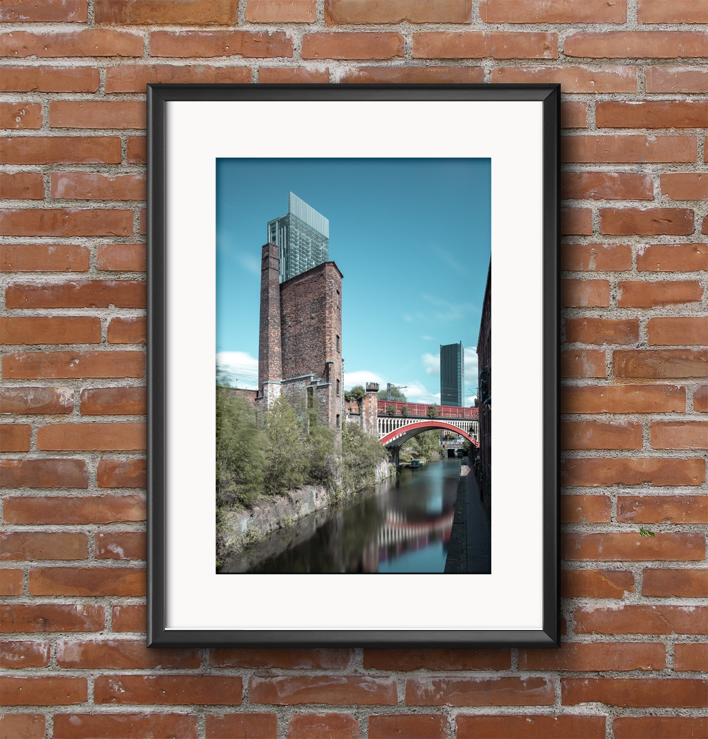 Manchester's three towers overlooking Castlefield canal.