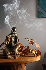 Incense and statue