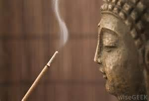 Buddha facing incense stick