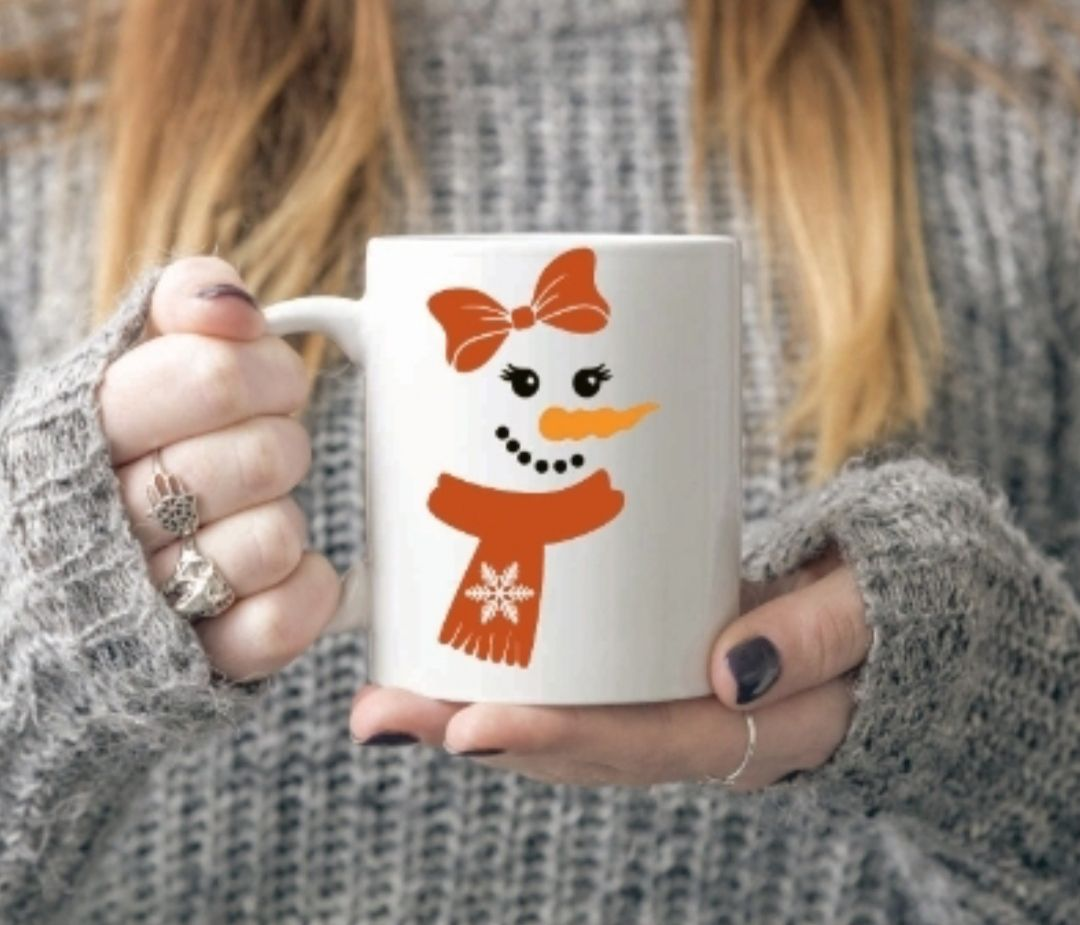 Snowman face mug with redy pink scalf