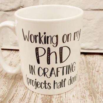 PhD in crafting Mug. Crocheting and knitting lovers mug